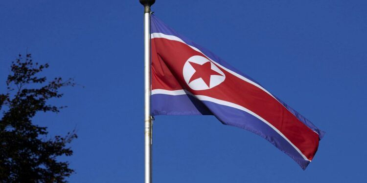 FILE PHOTO - A North Korean flag flies on a mast at the Permanent Mission of North Korea in Geneva October 2, 2014.   REUTERS/Denis Balibouse/File Picture