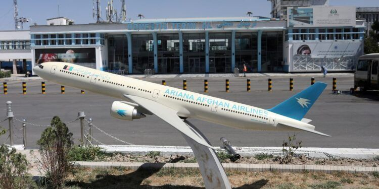 A model of an Ariana Afghan Airlines airplane is seen in front of the international airport in Kabul, Afghanistan, September 5, 2021. WANA (West Asia News Agency) via REUTERS